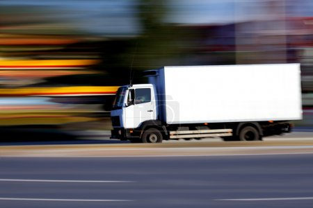 Photo for White truck on road on abstract blur background - Royalty Free Image