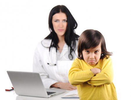 Young female doctor examining little cute angry child