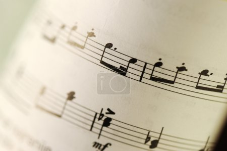 Closeup of old sheet music with selective focus and very shallow DOF