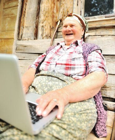 Photo for Senior aged woman with laptop - Royalty Free Image