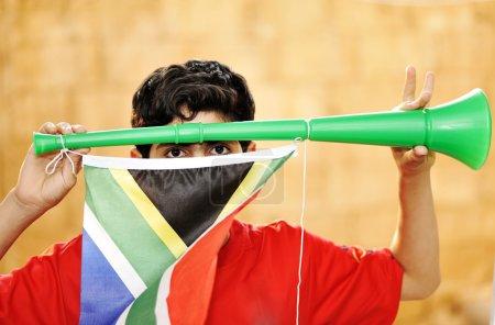Encourager with vuvuzela and flag