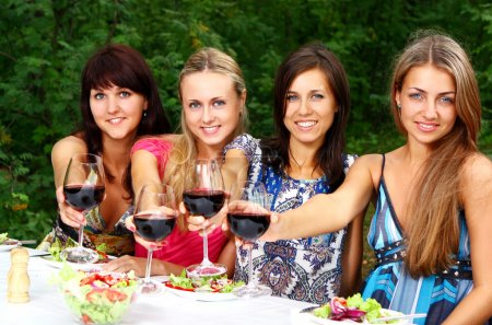 Group of Young Girls Drinking Wine in Park