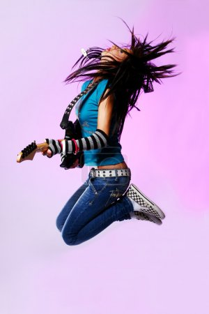 Emo girl jumping with guitar