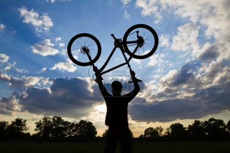 Photo for Mountain biker silhouette in summer - Royalty Free Image