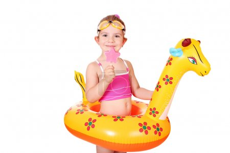 Little girl with ice cream and swimming rubber ready for beach