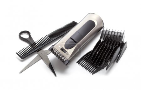 Clipper, comb and scissors on white background