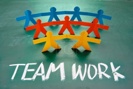 Photo for Teamwork words and colorful paper dolls on blackboard - Royalty Free Image