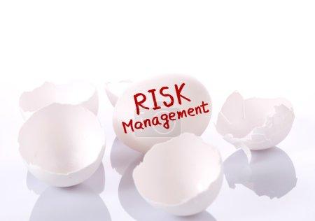 Photo for Risk management. Egg and broken eggshells on white background - Royalty Free Image