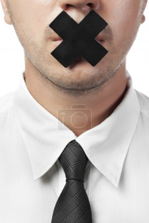 Man in shirt and tie with closed mouth isolated on white