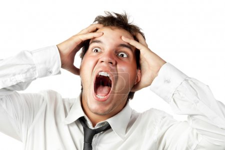 Young office worker mad by stress screaming isolated on white