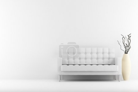 Photo for Leather couch and vase with dry wood in front of white wall - Royalty Free Image