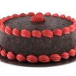 Round chocolate cake with pink cream isolated on w...