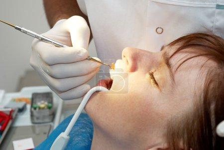 Dentist curing the patient's closeup