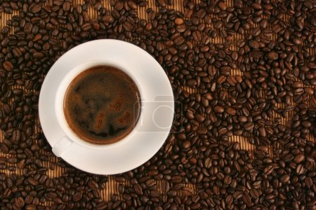 Photo for Cup of coffee on coffee beans - Royalty Free Image