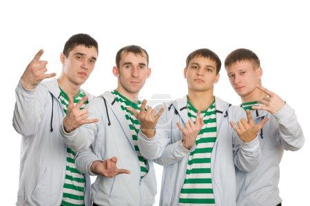 Photo pour Une équipe de jeunes hommes gesticulant des doigts. Isolé sur blanc . - image libre de droit