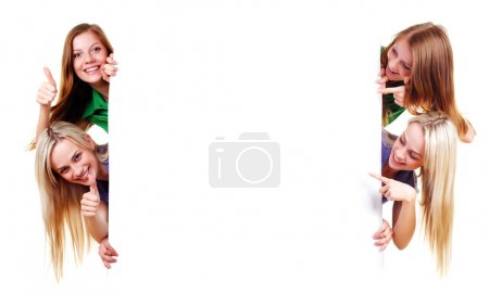 Photo for Two women with big white empty banner - Royalty Free Image