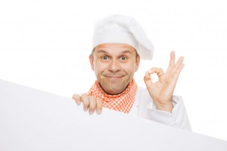 Photo for Smiling chef holding info board isolated on white background - Royalty Free Image