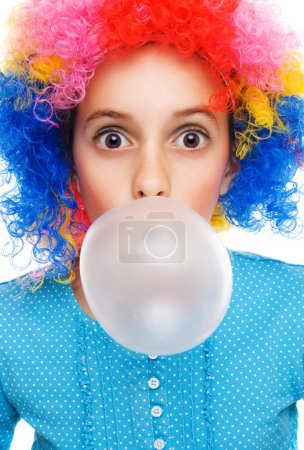 Young girl with clown wig and bubble gum