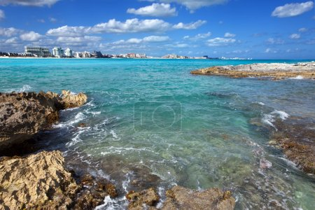 Cancun.Rocky coast, the sea and city in the distance