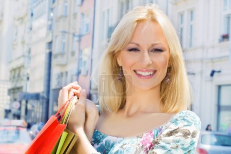 Photo for Happy shopping woman with bags. - Royalty Free Image