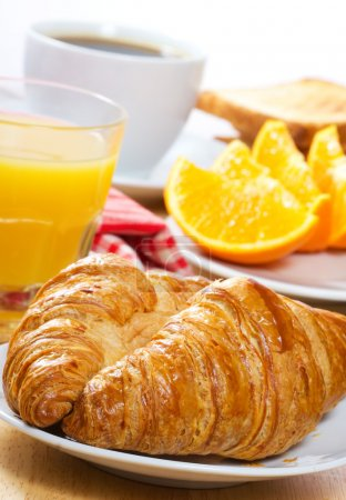 Photo for Breakfast with croissants, juice and coffee - Royalty Free Image