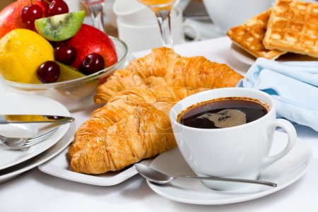 Photo for Breakfast with coffee, croissants and fresh fruits - Royalty Free Image