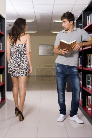 Photo for Guy getting really distracted from the libary books - Royalty Free Image