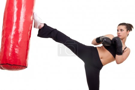 Photo for Woman Kick boxer with red punching bag- isolated on white - Royalty Free Image