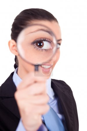 Woman looks through magnifying glass