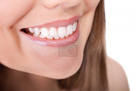 Photo pour Dents de femme et sourire, gros plan, isolé sur blanc - image libre de droit