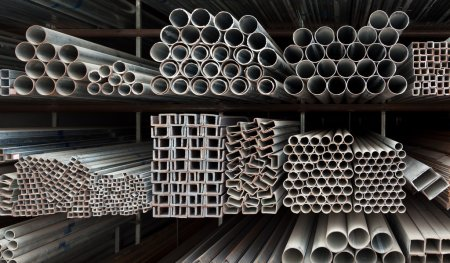 Photo for Metal pipe stack on shelf - Royalty Free Image