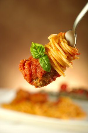 Photo for Spaghetti with meatballs and tomatoes sauce - Royalty Free Image