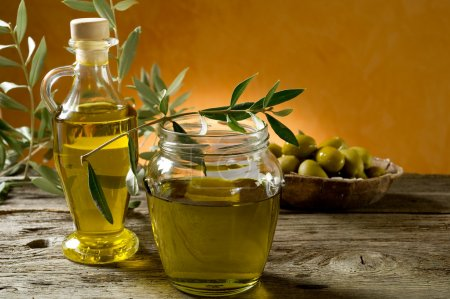 Photo for Olive oil on wood background - Royalty Free Image