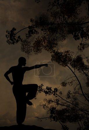 Photo pour L'homme spirituel pratique les arts martiaux Contexte texturé - image libre de droit