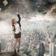 Portrait of young woman catching money on color ba...