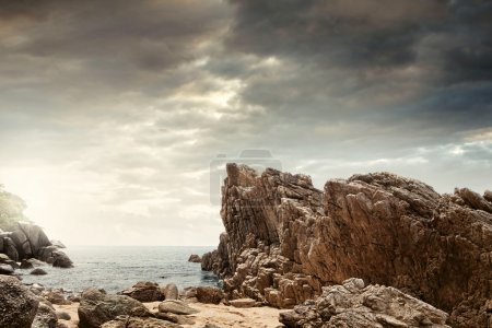 Photo for Panoramic view of nice colorful huge cliff and sea on the back - Royalty Free Image