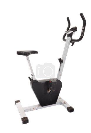 Photo pour Vélo stationnaire, machine de gym isolé sur blanc - image libre de droit