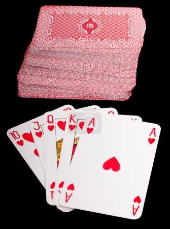 Photo pour Une quinte flush royale jeu de cartes poker la main dans les coeurs - image libre de droit