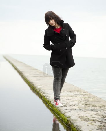 Young teen girl at outdoor near water.