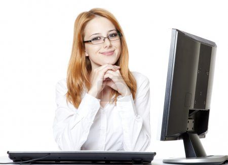 Smiling young business woman using computer