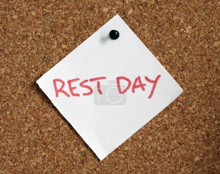 Photo for Close up of rest day reminder attach to cork board - Royalty Free Image