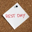 Close up of rest day reminder attach to cork board...