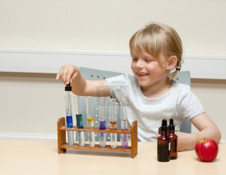 Child playing scientist
