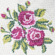 Old cross stitch embroidery of rose and leaves...