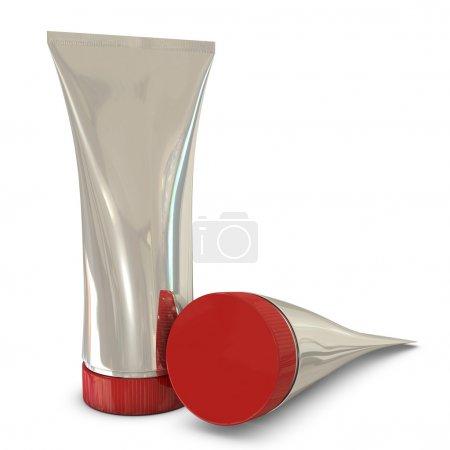 Photo pour Paquets de tubes argentés avec bouchons rouges isolés sur fond blanc - image libre de droit