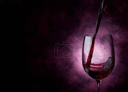 Photo for Photo of Red Wine inside a wine glass with abstract background - Royalty Free Image