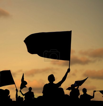 Silhouette of street protestors with flags and ban...
