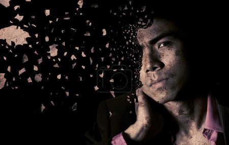 Photo for Lonely Asian businessman with shatter face and sad expression in dark black background - Royalty Free Image