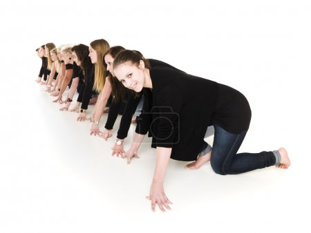 Photo for Row of young women in start position isolated on white background - Royalty Free Image