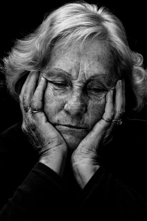 Black and white depressed senior woman